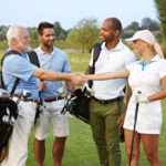 Golf foursome shaking hands.